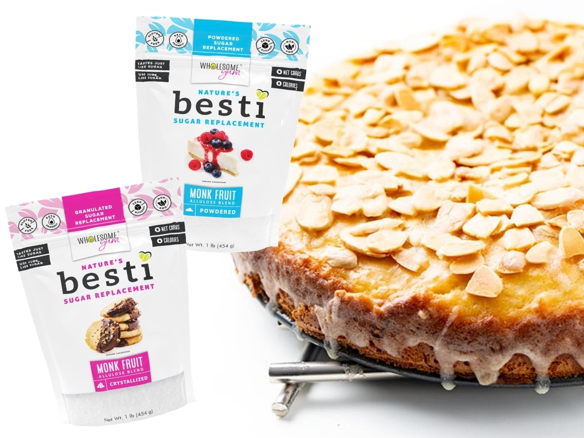 French almond cake with bags of Bestii alongside it