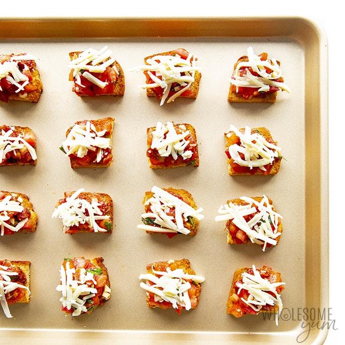 Keto bruschetta pieces on a pan