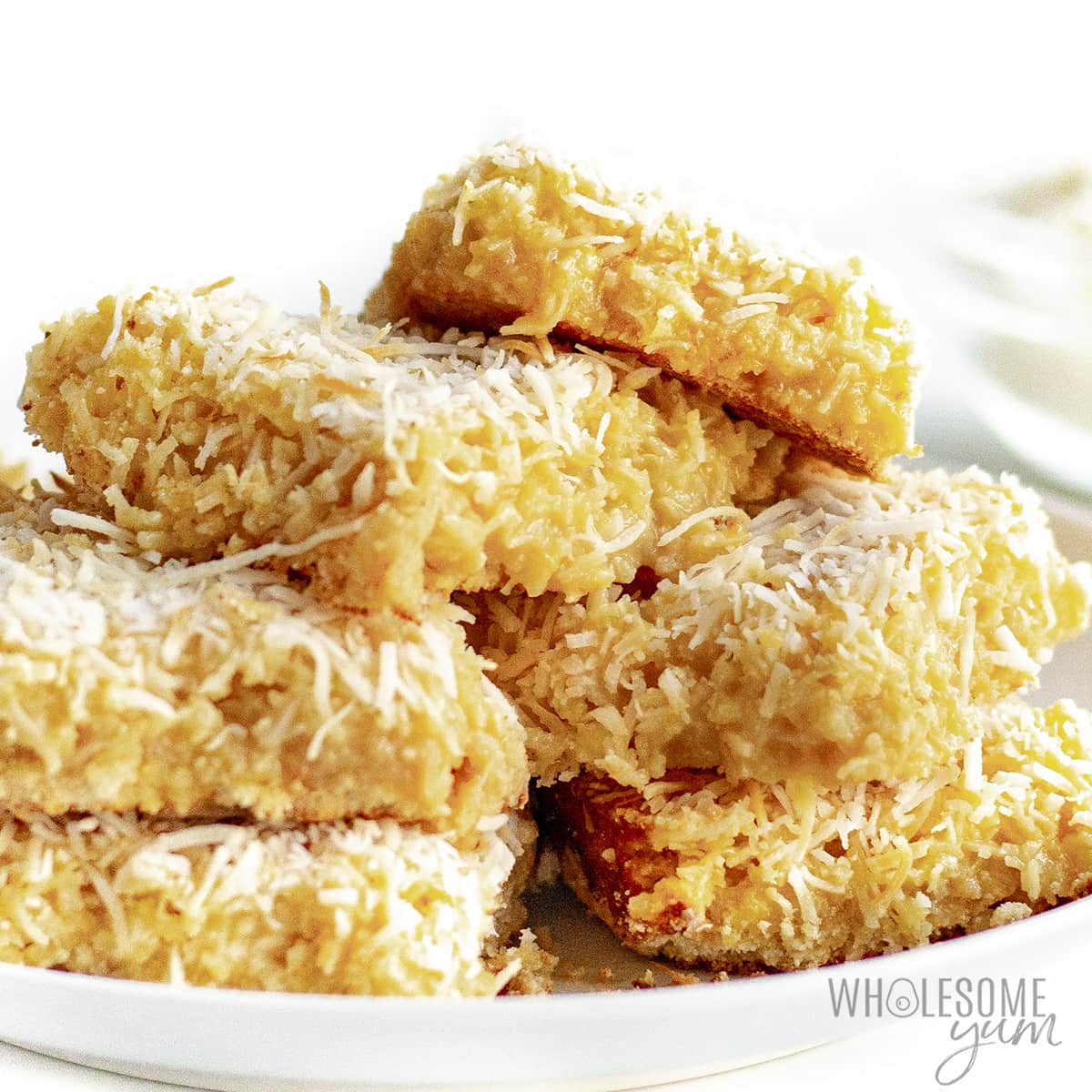 Coconut bars stacked on a plate